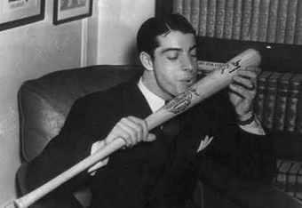 DiMaggio kisses his bat following his great 1941 season.